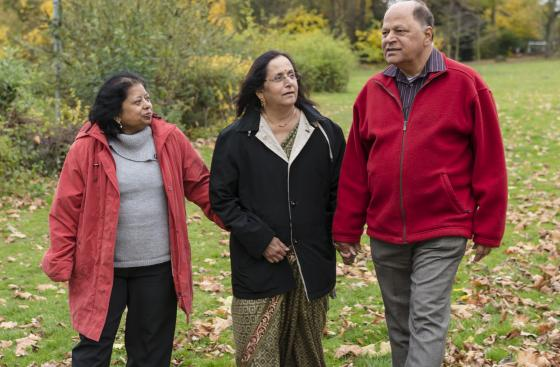 Alka, who has Parkinson's, walking with her family