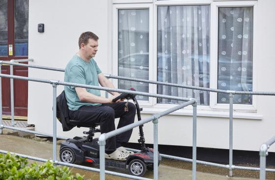 Darren Hoult, who has Parkinson's, coming down a ramp in his wheelchair
