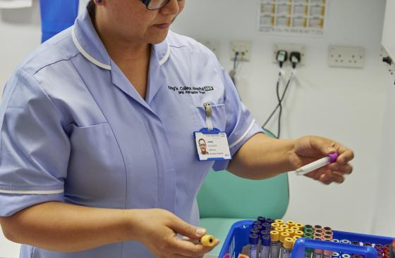 A nurse sorts medical equipment