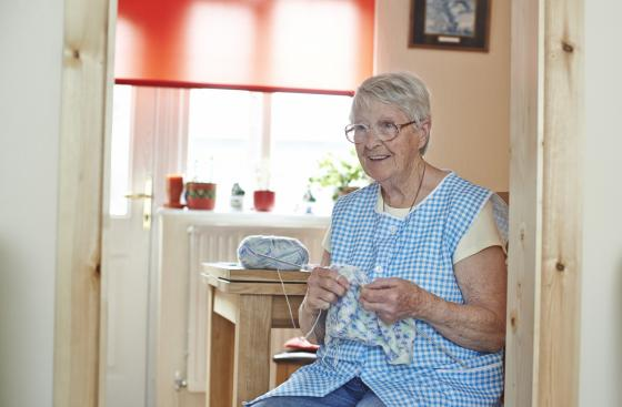 Rose, who has Parkinson's, knitting