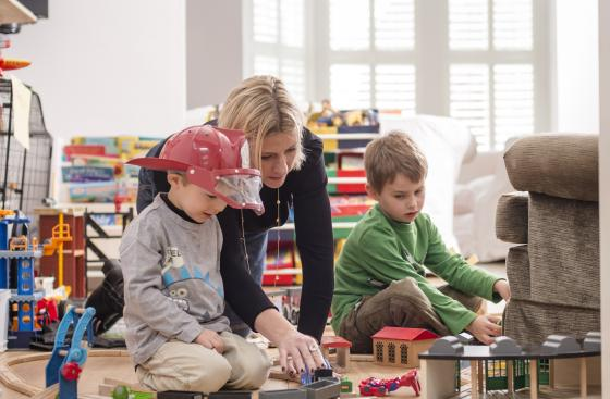 Sarah Webb playing with her children