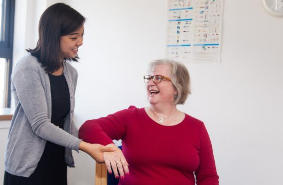 A researcher treating a Parkinson's patient
