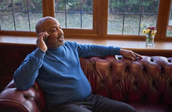 Lew Isaac, who has Parkinson's, talking on the phone