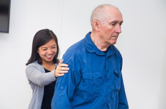 Researcher with person with Parkinson's