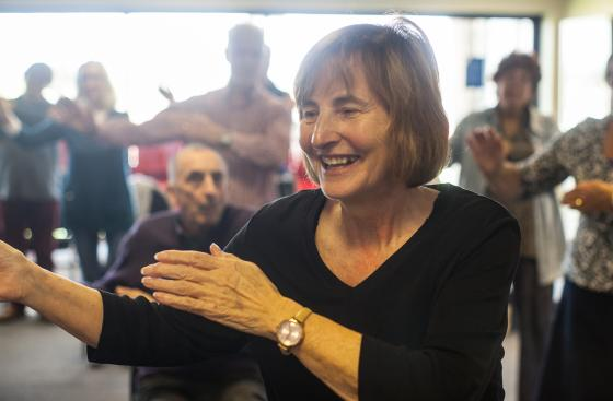 Image of woman smiling at Parkinson's exercise class