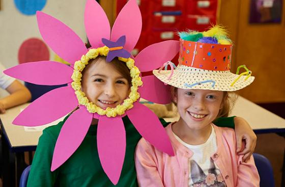 Children at school wearing colourful hats for Use Your Head day