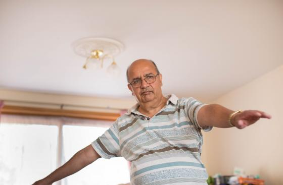 Man with Parkinson's exercising at home