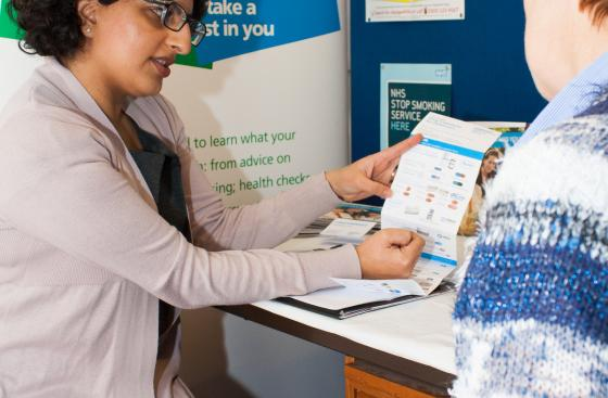 Pharmacist using a resource with a customer