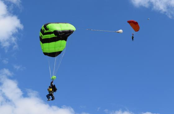 Two skydivers mid-jump