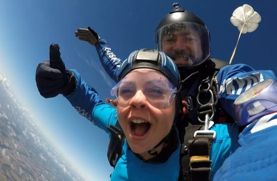 Parkinson's UK skydiver mid-jump