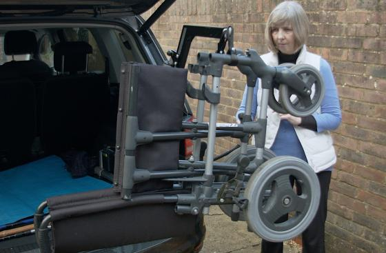 Janet Roberts, who has Parkinson's, loading a wheelchair into her car