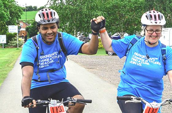 Two cyclists celebrate as they finish Pedal for Parkinson's