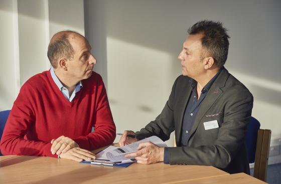 A person with Parkinson's talking to a Parkinson's local adviser