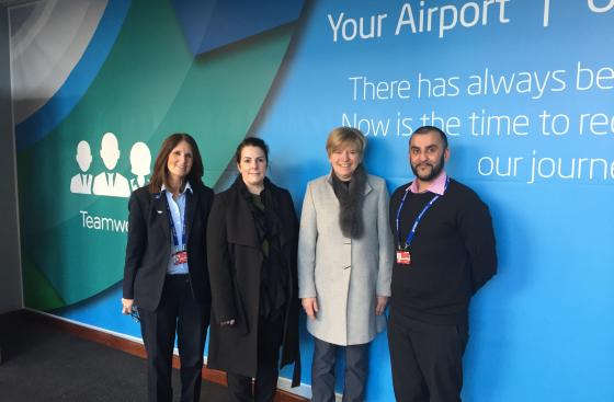 Carer of a person with Parkinson's, a member of Parkinson's UK staff and staff from Belfast International Airport