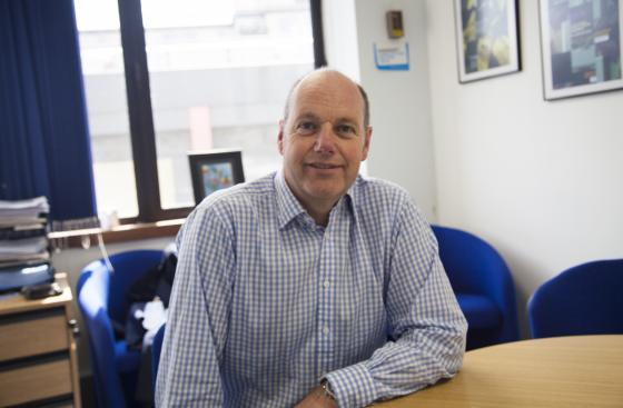 Steve Ford, CEO, Parkinson's UK sitting at a desk