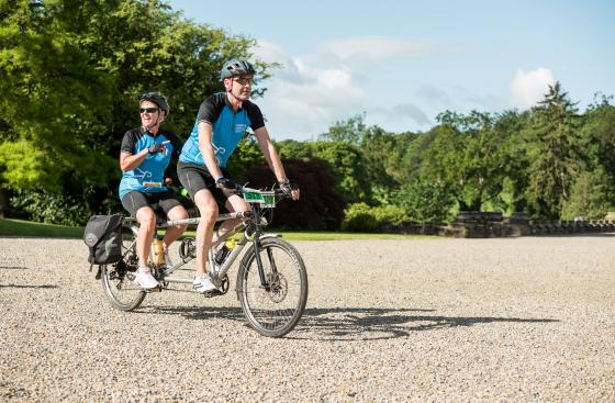 Parkinson's UK cyclists on a tandem cycle