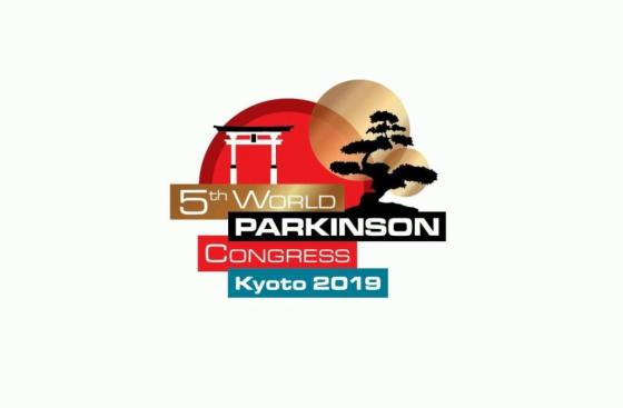 Text in gold, black, red, and blue boxes saying 5th World Parkinson Congress Kyoto 2019, on top of a background featuring a red sun, a Japanese torii syle gate, and the silhouette of a bonsai tree