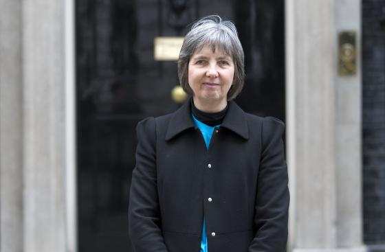 janet roberts stands outside number 10