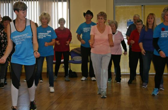 Group of people at a Parkinson's line dancing class