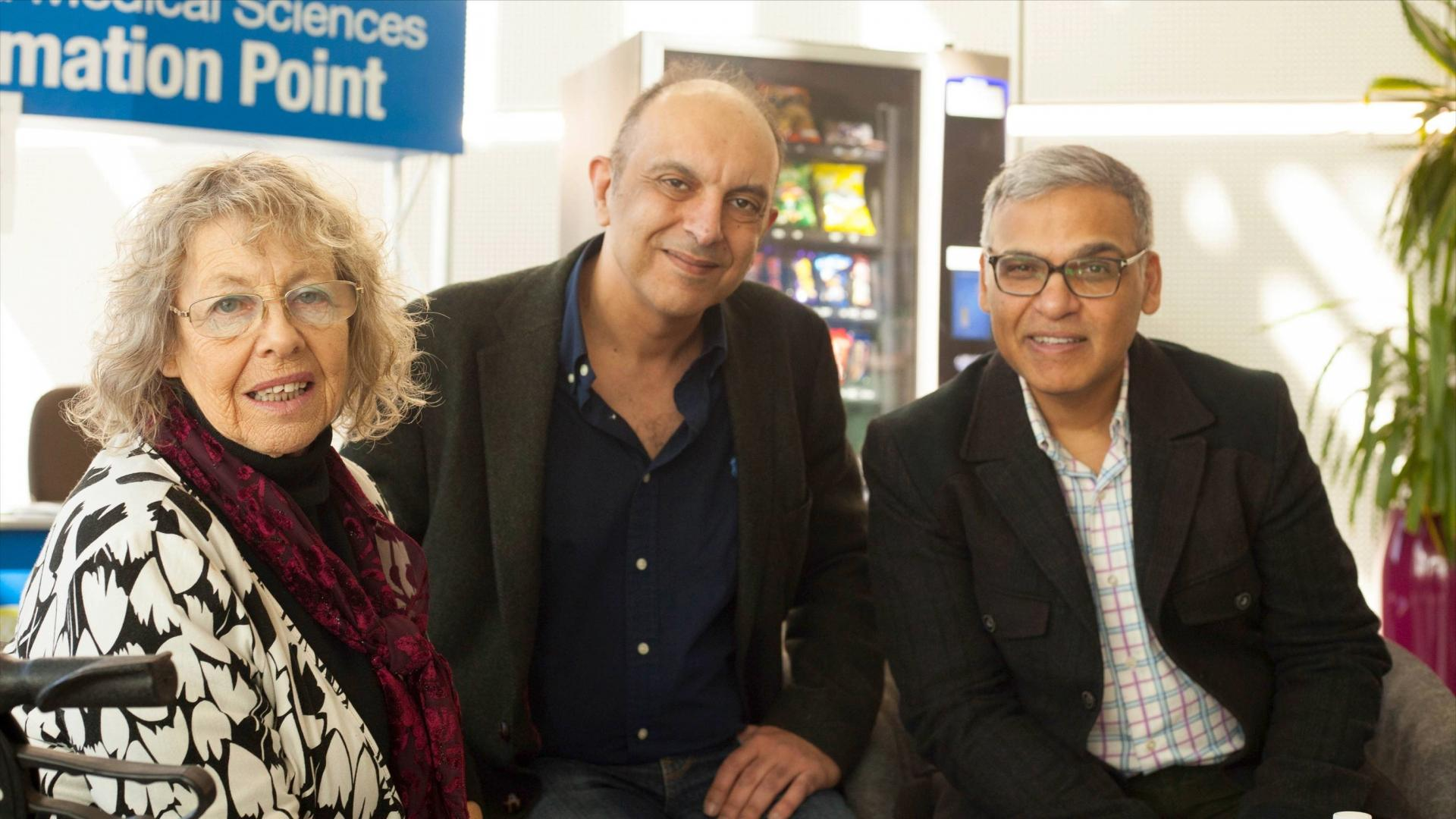 June, who has Parkinson's, with Dr Mohammed Shoaib and Dr Mahmoud Iravan - researchers working on the relationship between nicotine and Parkinson's.