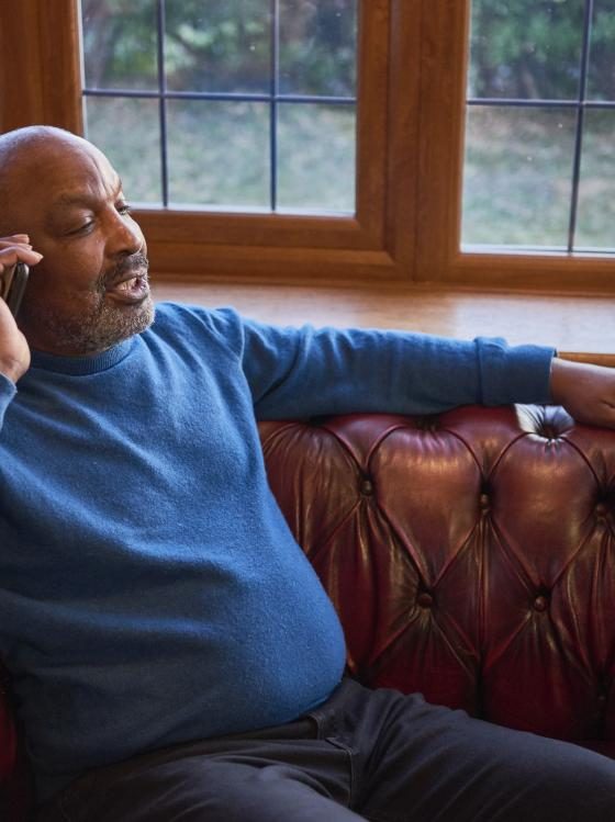 Lou Isaac, who has Parkinson's, talking on the phone