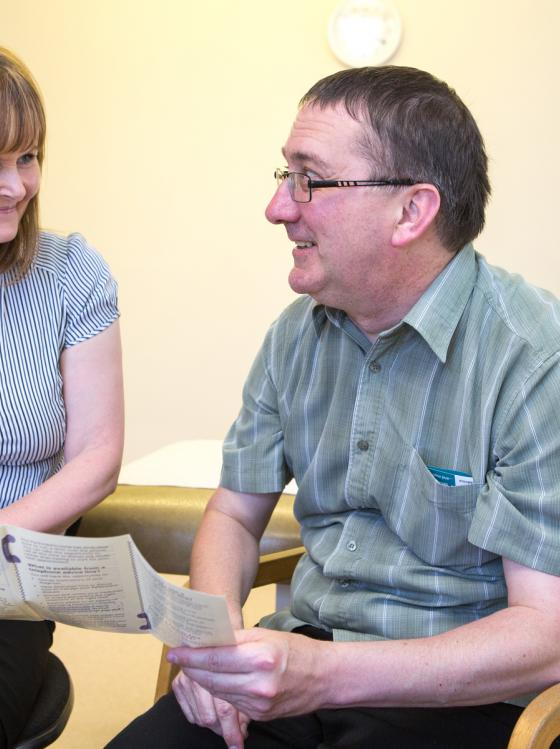 Consultant and person with Parkinson's share information