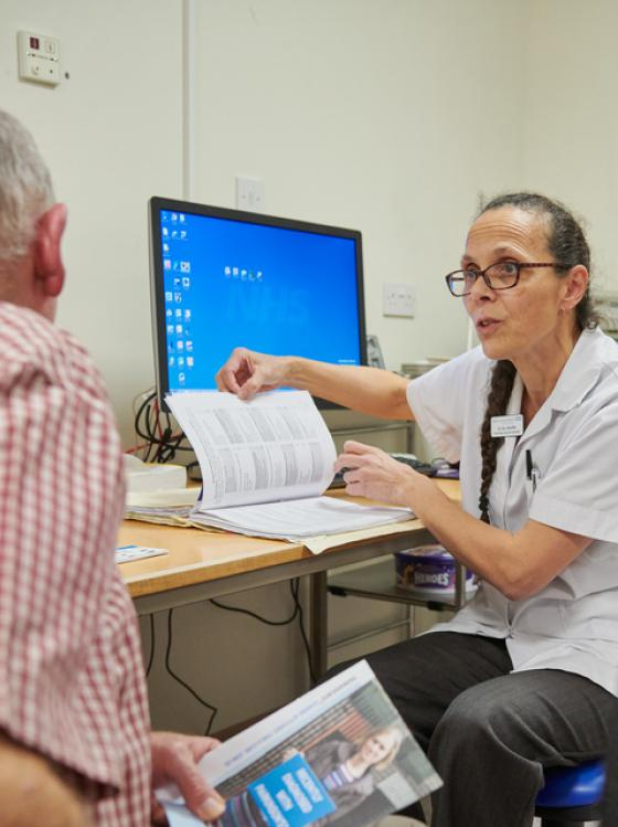 Consultant completes paperwork with a patient