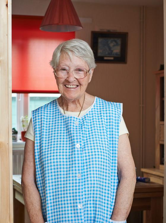 An older woman with Parkinson's smiling