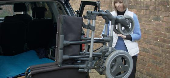 Janet Roberts loading her wheelchair into her car