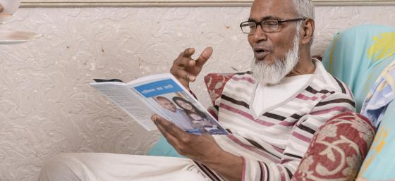 A man reading an information booklet