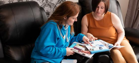 A young woman with Parkinson's talking to her Parkinson's local adviser