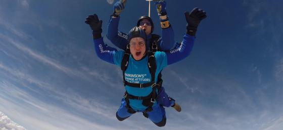 Skydiver mid-jump with Parkinson's UK t-shirt