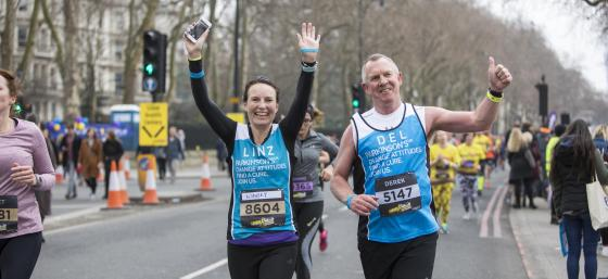Photo of 2 runners waving