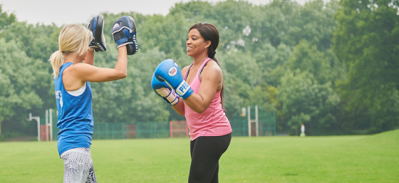 Omotola, a young woman with Parkinson's, boxing in the park with her personal trainer