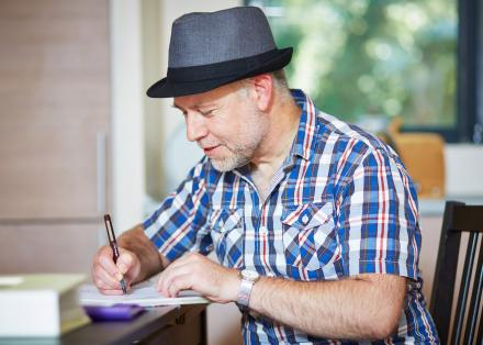 Paul, who has Parkinson's and is an artist, drawing