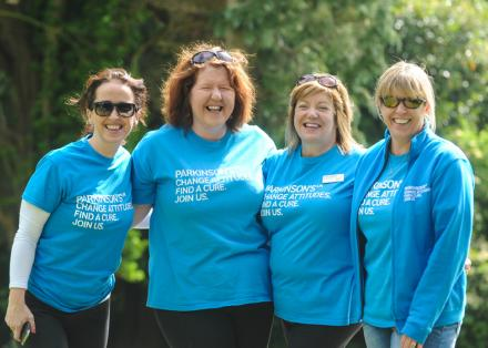 Four ladies in Parkinson's UK tops