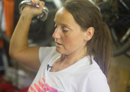Younger woman with Parkinson's using kettlebell weights
