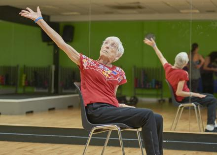 Older woman with Parkinson's doing seated exercise