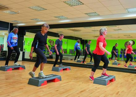 People using step blocks in Parkinson's exercise class