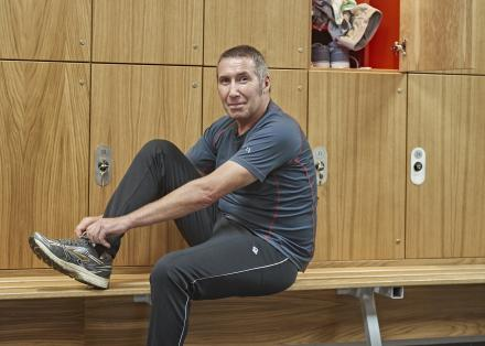 Man with Parkinson's in gym changing room