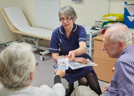 Parkinson's nurse gives information to a carer